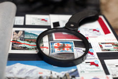 Georgian flag on postage stamp. Enlarged under a magnifying glass royalty free stock photos