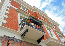 Georgian homes. Photo of georgian homes with balcony and pretty flower boxes in historic town of rochester in kent england. photo taken 27th july 2015 ideal for royalty free stock image