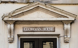 Georgian House Plaque With Old Pediment. Horizontal photography Royalty Free Stock Photos