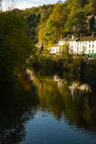 Georgian houses at Matlock Bath, Derbyshire. Autumn reflections in the Derwent at Matlock Bath, Derbyshire royalty free stock photo