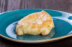 Georgian khachapuri flatbread or flat cake with cheese on a plate Homemade baking. Top view. royalty free stock photo