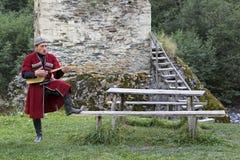 Georgian man plays local musical instrument of panduri and sings traditional svanetian songs in Ushguli, Caucasus Mountains, Georg royalty free stock images