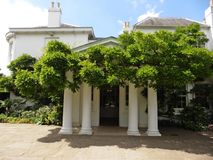 The front entrance of Pembroke Lodge in Richmond London. This georgian mansion is situated in richmond park greater london,it is a venue for weddings .it is Royalty Free Stock Photos
