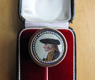 Georgian pin stick jewellery. Photo of a georgian pin stick showing miniature painting on enamel of a georgian gentleman dated to around mid eighteenth century Stock Images