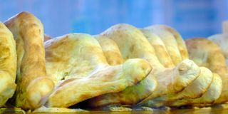 Georgian shoti. Georgian bread, Georgian cuisine, wooden shelf for freshly baked bread.  stock image