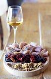 Georgian snacks: walnuts, dried fruits, churchkhela and white wine royalty free stock photos