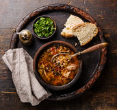 Georgian soup Kharcho with meat and rice. Traditional Georgian soup Kharcho with meat and rice on wooden background stock image