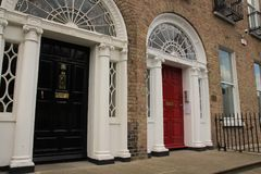 Georgian black and red door in the city Dublin in Ireland. Royalty Free Stock Photography