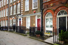 Georgian Style London. London, England - March 24, 2015: Business and residential homes in the Georgian Style in London, England. Average house prices fell by 0 stock images