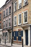 Georgian terraced houses. Georgian terraced town houses in Spitafields in the East End of London, England, UK, which where the homes of wealthy Huguenot silk Stock Photography