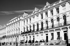 Georgian terraced town houses. Black and white monochrome photograph picture of  expensive old fashioned typical Regency Georgian terraced town houses building Stock Photo