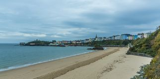 The Georgian town of Tenby and Goscar Rock at sunrise Royalty Free Stock Images