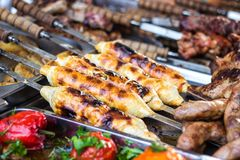 Georgian traditional dish - khachapuri, pastry with cheese on a skewer fried on the grill. Fresh hot tasty street food in the mark royalty free stock photos