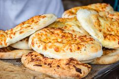 Georgian traditional dish khachapuri, pastry flat cake cheese-filled bread fried on the grill, BBQ. Fresh hot tasty street food in royalty free stock images