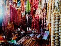 Georgian wide range of colourful traditional food on sale in small street market shop - closeup on sausage-shaped churchkhela stock image