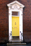 Georgian Yellow doorway. Bright yellow painted georgian door and decorated doorway Stock Photography
