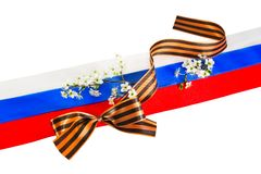 Georgievsky tape against of Russian flag Stock Photo