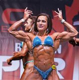 Curvy Female Physique Athlete Poses at 2018 Toronto Pro Supershow Royalty Free Stock Photography