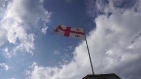 Georgische wellenartig bewegende Flagge stock footage