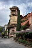 2018 04.23 Georgiy, Tbilisi, Tbilisi clock tower in the old town, near the puppet theater. The picturesque tower falls. royalty free stock photography