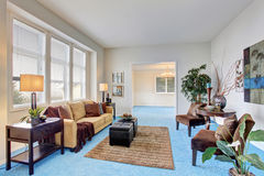Georgous living room with bright blue carpet. Stock Photo