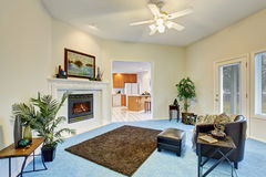 Georgous living room with bright blue carpet. Stock Image