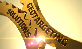 Geotargeting lösningsbegrepp Guld- metalliska kuggekugghjul Arkivfoton
