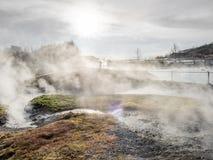 Geotermico dello stagno della sorgente di acqua calda in Islanda Fotografie Stock