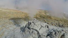Geothermal activities - mud volcano eruption clouds of vapor, hot gas. Geothermal activities on Kamchatka Peninsula - view of mud volcano eruption clouds of stock footage