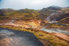 Geothermal area with colorful mineral rocks stock image