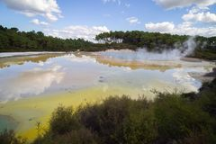 Geothermal area gives a palette with colors on shiny and hot water stock photos