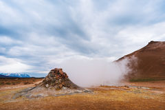 Geothermal area Namafjall with steam eruptions, Iceland, Europe. Landscape with eruption steam. Geothermal area Namafjall, Iceland, Europe. Overcast day Royalty Free Stock Photos