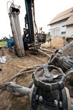 Geothermal drilling machine. In action. Source for renewable energy for a private house royalty free stock photo
