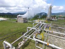 Geothermal Energy. A worker operates machinery at the Ulubelu geothermal power plant, owned by Pertamina A worker operates machinery at the Ulubelu geothermal royalty free stock photos