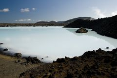 Geothermal lake in lava field. Filled with turquoise water, Iceland Royalty Free Stock Photos