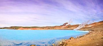 Geothermal landscape with beautiful azure blue crater lake, Myvatn area, Iceland. Panoramic view of geothermal landscape with beautiful azure blue crater lake royalty free stock image