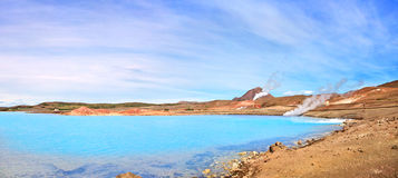 Geothermal landscape with beautiful azure blue crater lake, Myvatn area, Iceland Stock Photography