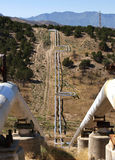 Geothermal pipes. Geothermal tranmission pipes following a valley, Blundell Geothermal Plant, Utah Stock Image