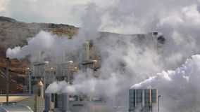 Geothermal power plant. In Iceland, strong heat haze in the air stock footage