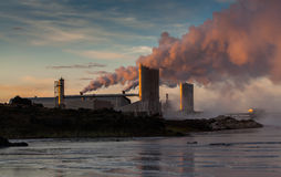 Geothermal Power Plant. Image of a geothermal power plant in sunset stock photos