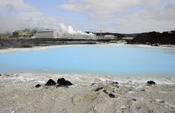 Geothermal power plant near a blue lagoon Royalty Free Stock Photos
