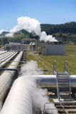Geothermal power plant pipes perspective Royalty Free Stock Photos