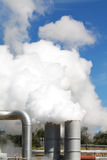 Geothermal power plant pipes and steam Royalty Free Stock Photography