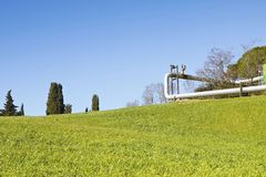 Geothermal power plant in Tuscany hills Italy - Image with cop Royalty Free Stock Photos