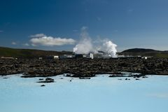 Geothermal power station. In Iceland, in foreground turquoise geothermal water Stock Images