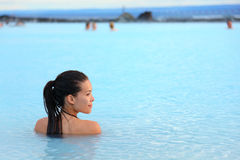Geothermal spa - woman relaxing in hot spring pool. Geothermal spa. Woman relaxing in hot spring pool on Iceland. Girl enjoying bathing in a blue water lagoon stock photography