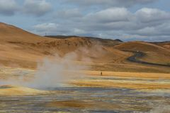 Geothermal spring hot water energy plant near Myvatn. Steaming hot water from Krafla volcano in Iceland Stock Photos