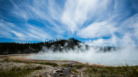 Geothermal with steam in yellowstone park. Geothermal with steam under blue sky and white cloud in yellowstone park royalty free stock photo
