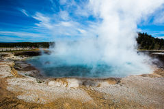Geothermal with steam in yellowstone park. Geothermal with steam under blue sky and white cloud in yellowstone park royalty free stock images