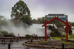 Geothermal Steam at Whakarewarewa, Rotorua, NZ. Steam rising from geothermal vents behind a Maori arch at Whakarewarewa Living Maori Village in Rotorua, New Stock Images